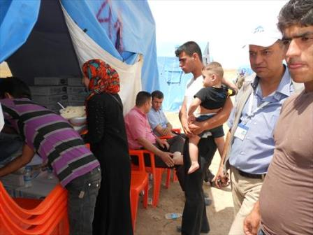 A young Iraqi couple from Mosul check into Kelek camp after arriving on foot. 13 June 2014