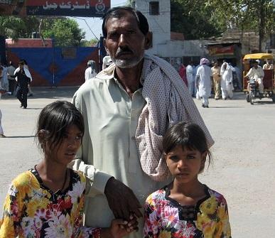 Ashiq Masih (husband of Asia Noreen [Bibi], with two daughters.