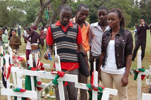 Kenyans light candles in memory of the 148 students who lost their lives in the April 2 attack.