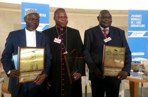 Left to right: Imam Oumar Kobine Layama, Msgr. Dieudonné Nzapalainga and Rev. Nicolas Guérékoyamé-Gbangou received the 2015 Sergio Vieira de Mello Prize at the UN office in Geneva, Switzerland on 19 Aug.