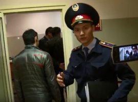 A policeman is filmed during the Good Friday raid on New Life church in Almaty, Kazakhstan. Photo:  Maxim Maximov / YouTube