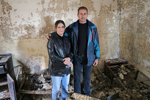 Almas and her husband, Hathem, stand inside the remains of their house, destroyed by IS, Jan 2017.