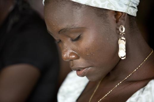 A Christian woman at a church service in Nigeria.