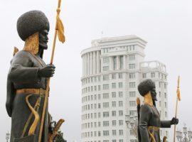 Hero statues at Ashgabat Independence Monument. City of Ashgabat, Turkmenistan.